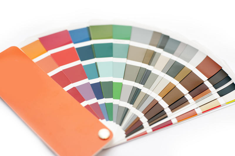 Opened color chart for interior decorating or typography displayed fanned on a white background in a DIY and renovation concept