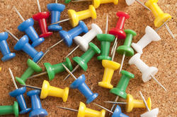 10796   Colorful Sharp Pins on Top of Cork Board