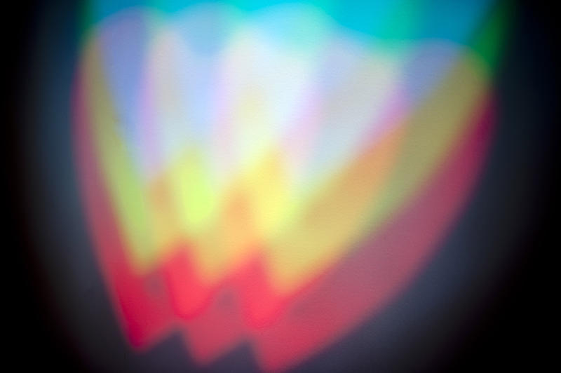 colorful abstract heart shapes created with beams of light and a gobo