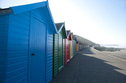7840   Brightly coloured beach huts, Whitby West Cliff