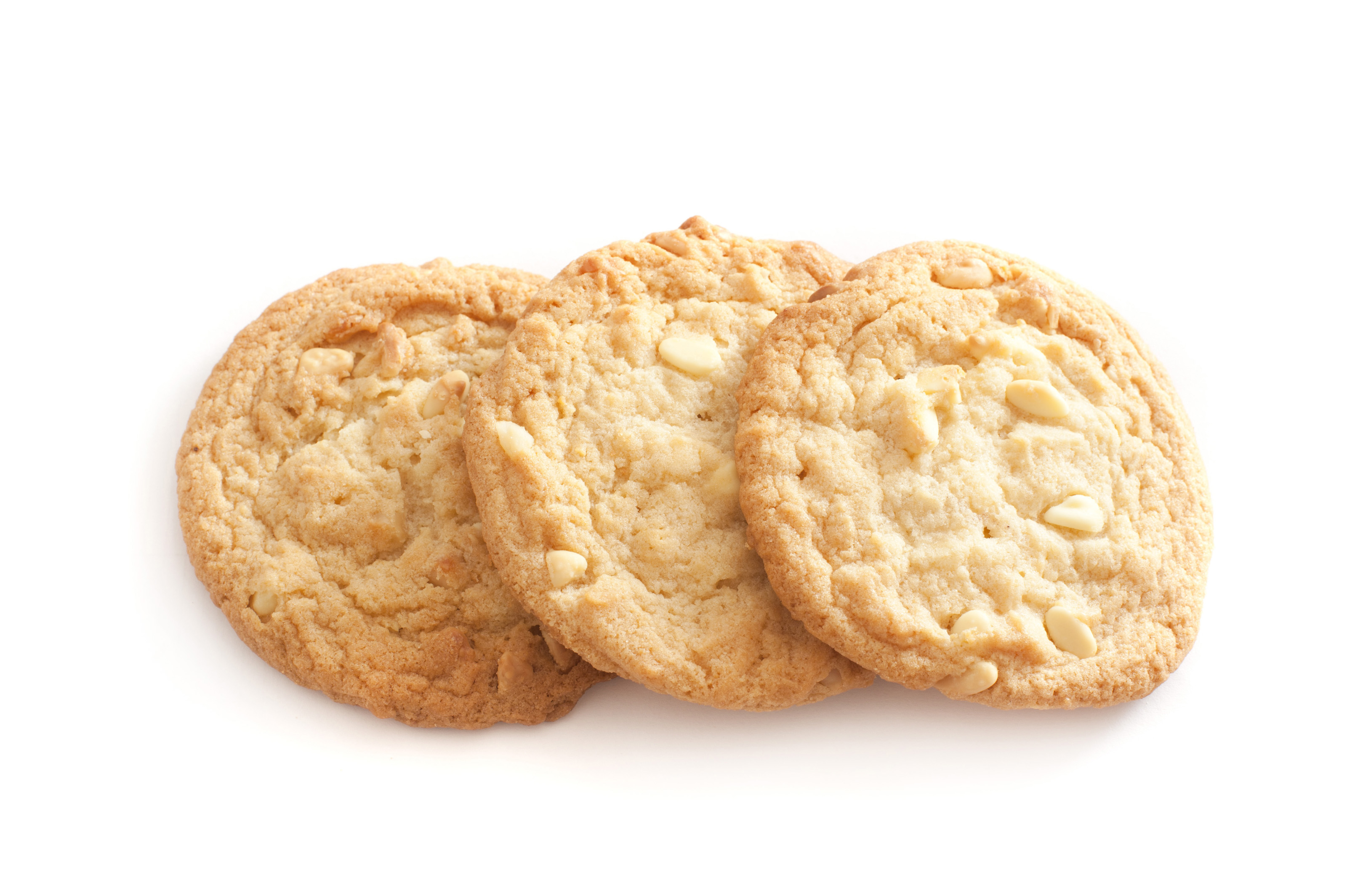 Three golden fresh crunchy nut cookies arranged in an overlapping line ...
