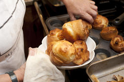 9950   Woman cooking Yorkshire Puddings