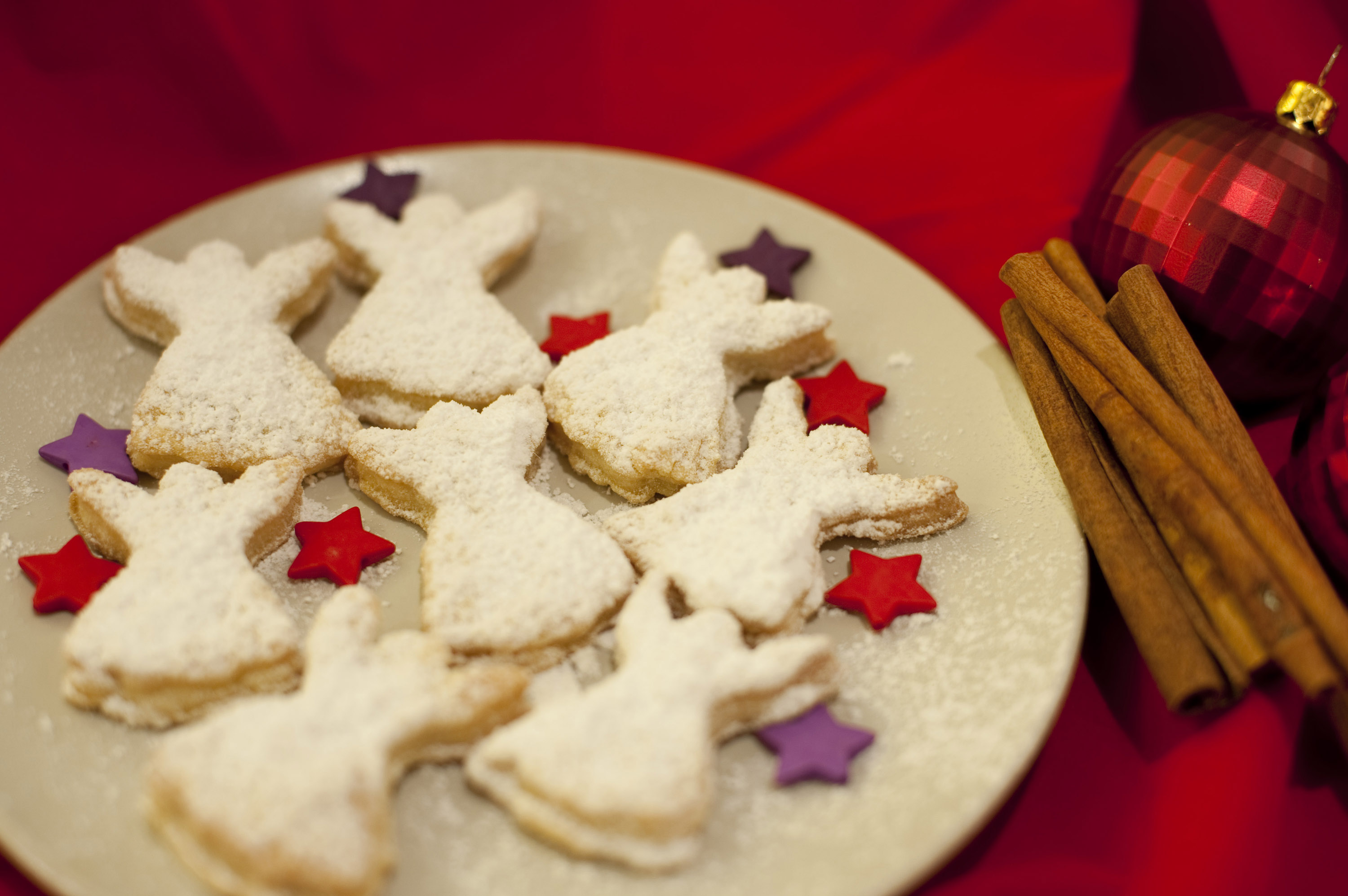 Fresh Home Baked Angel Christmas Cookies Arranged With Colourful Stars On A Plate On A Festive
