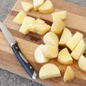 10607   Fresh Slices of Uncooked Potatoes on Wooden Board