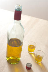 11598   Bottle of whiskey with two full glasses