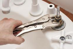 10164   Man repairing a broken faucet or tap