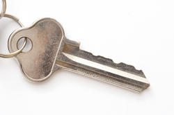 10635   Single Door Key Isolated on White Background