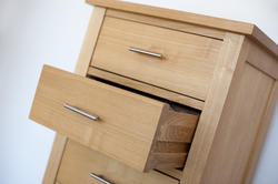 10661   Small wooden chest of drawers