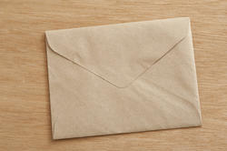 10574   Closed Brown Envelope on Wooden Table