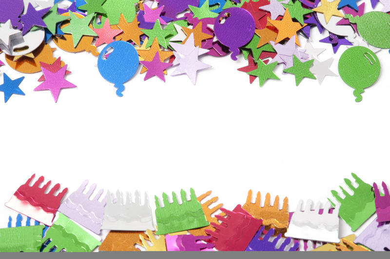 Festive border of multicolored confetti in a variety of shapes on a white background with copyspace for your invitation to a party celebration or event