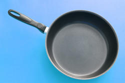10638   Black Frying Pan on a Sky Blue Gradient Background