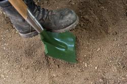 9844   Garden spade alongside old boots