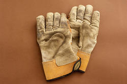 9853   Pair of old leather gardening gloves