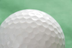 10987   Close up of a white golf ball