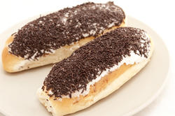 10414   Iced bun topped with chocolate sprinkles