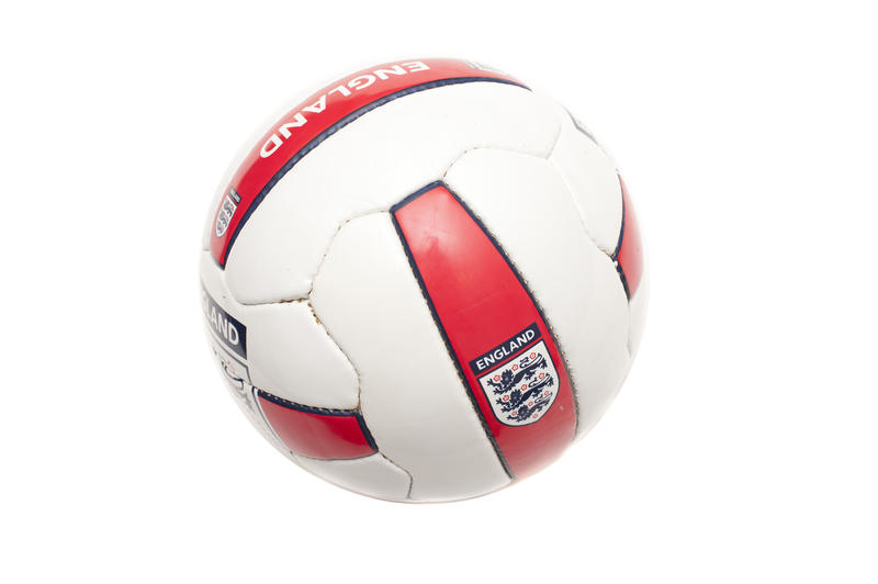 Isolated England soccer ball in red and white with the English emblem for the World Cup Soccer isolated on white
