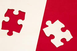 10759   Puzzle piece in red and white