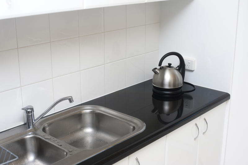 Small Stainless Steel Sink Units : Small kitchen with double stainless steel sink unit, black countertop ...