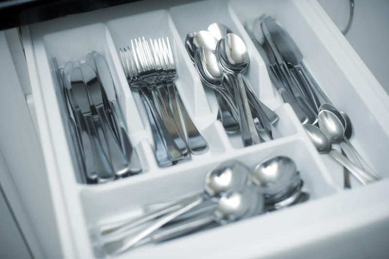 a nerrow depth of field image of the inside of a kitchen cutlery drawer