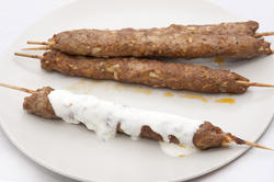 8461   Grilled kofta kebabs drizzled in yoghurt