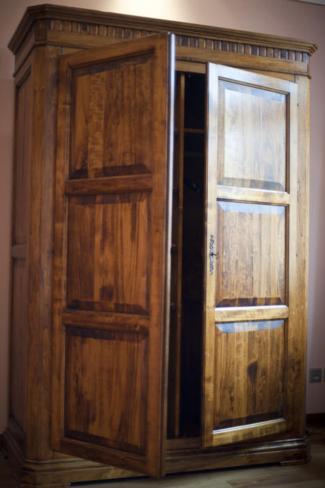 Wooden Wardrobe Styles : Rustic large wooden wardrobe or armoire with the doors ajar to reveal ...