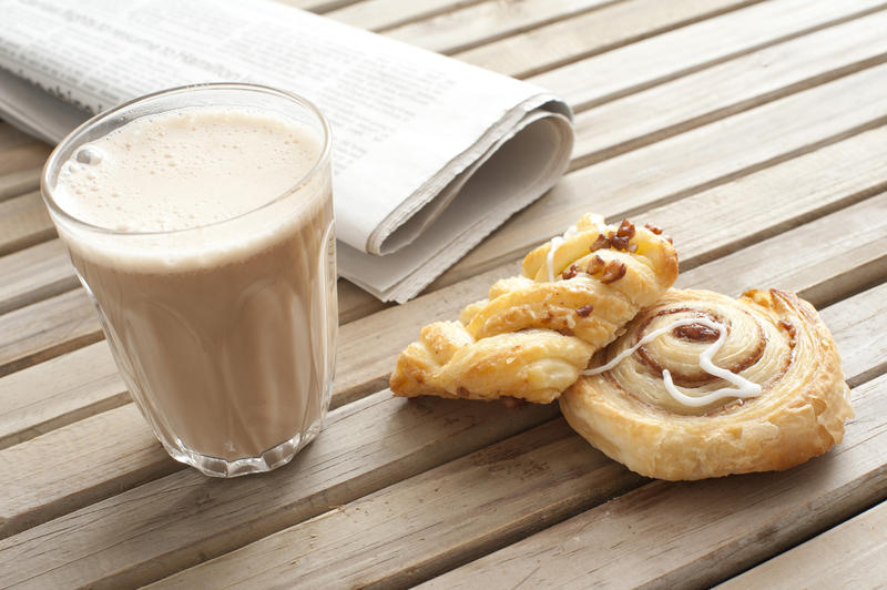 11655   Cup of cacao, pastry and fresh newspaper
