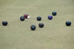 10992   Bowls lying around a jack on a bowling green