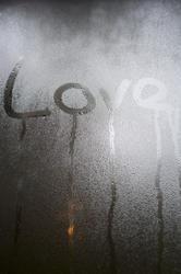 10578   Love written in condensation on glass