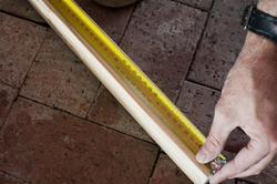 10170   Man measuring a length of wood