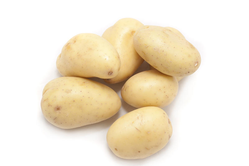 Pile of young cleaned fresh new potatoes for vegetarian and vegan cuisine or for use in salads and cooking as a vegetable rich in carbohydrate and nutrients