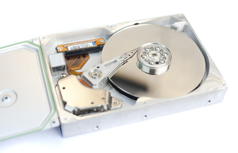 Close up Internal Parts of a Typical Computer Open Hard Disk Isolated on White Background.