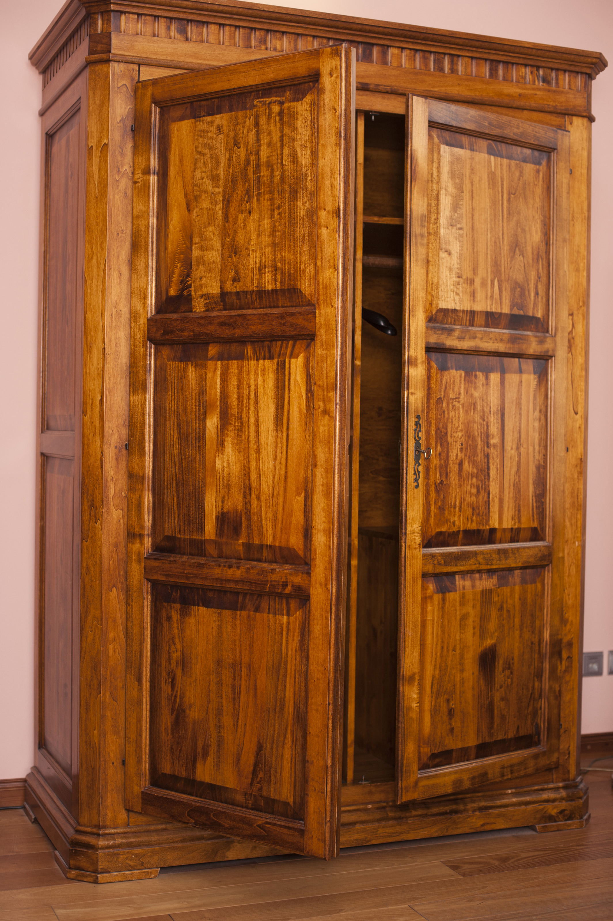 Old Rustic Wooden Wardrobe With Paneled Doors Standing Ajar To Reveal . Full resolution  img, nominally Width 2129 Height 3200 pixels, img with #AD5301.