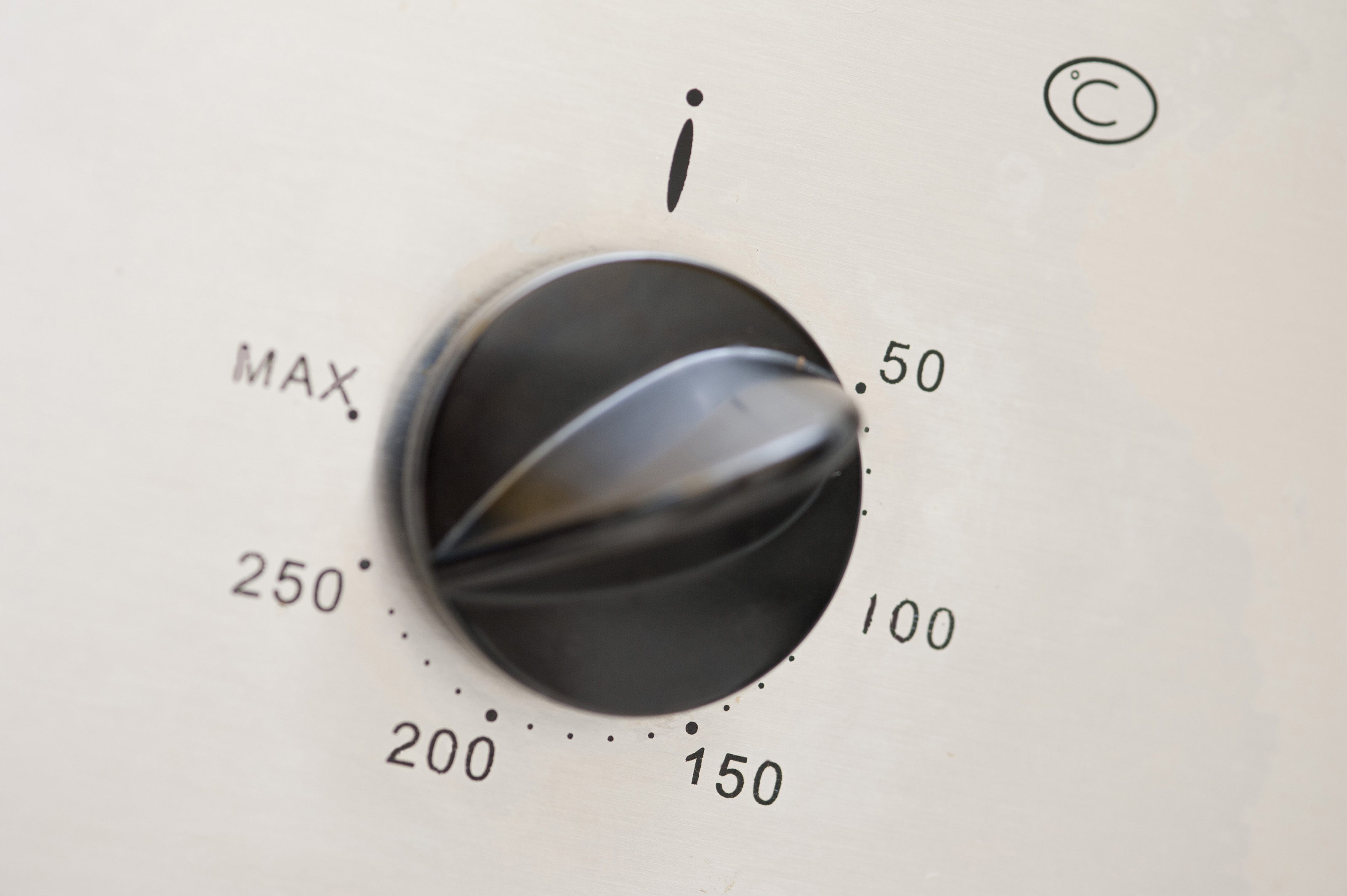 Temperature control on an oven with a circular dial and knob showing a  #746757