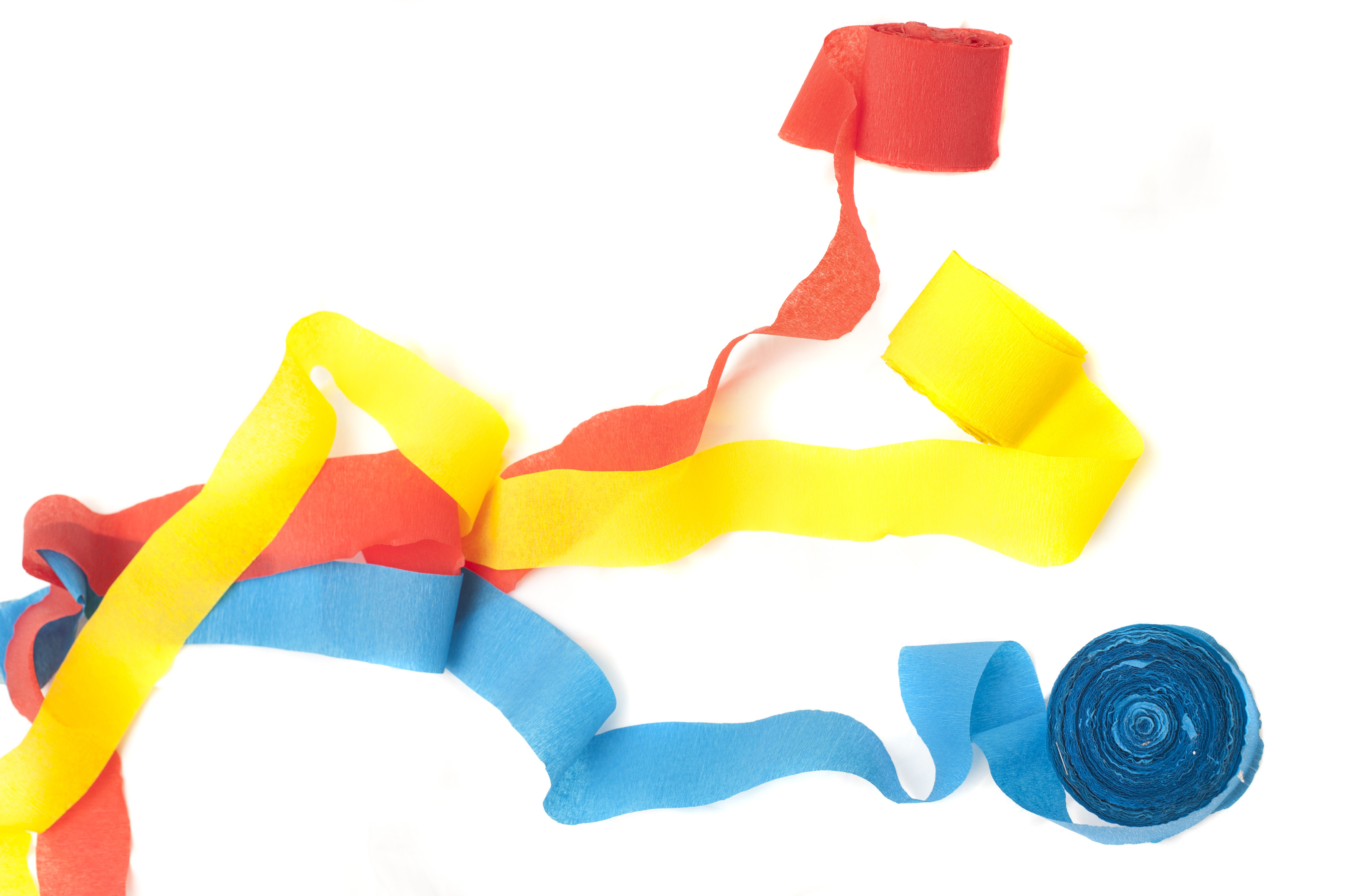 Three colorful party streamers in red blue ad yellow isolated on a