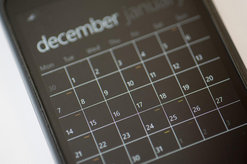 Close up Calendar Application on a Modern Black Touch Screen Mobile Phone with White Background.