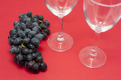 11659   Grapes on Red Background with Empty Wine Glasses
