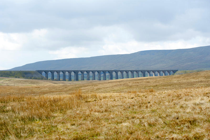 Landscape view of the historic Ribblehead viaduct, a Victorian railway viaduct crossing the River Ribble in North Yorkshire