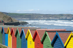 7842   Beach huts at Whitby sands, West Cliff