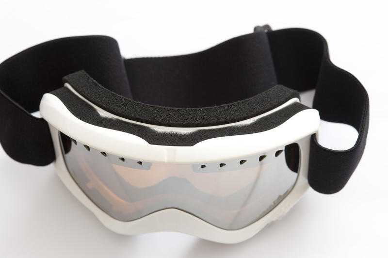 Snowboarding goggles on a white background in a winter sport, vacation and healthy active lifestyle concept