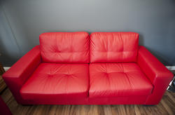 10665   Comfortable red upholstered leather sofa