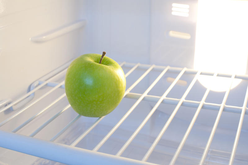 8287   Single green apple inside a fridge