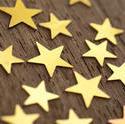 11201   Golden stars isolated on wood
