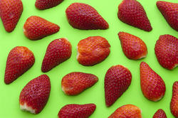 8522   Background of halved strawberries on green