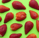 stock image 8522   Background of halved strawberries on green