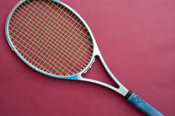 11007   Tennis Racket Isolated on Dark Pink Background