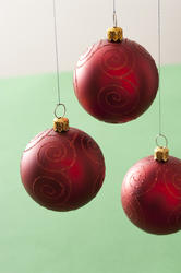 11694   Three hanging red Christmas baubles