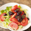 10523   Bowl with green salad, grapes and tomatoes