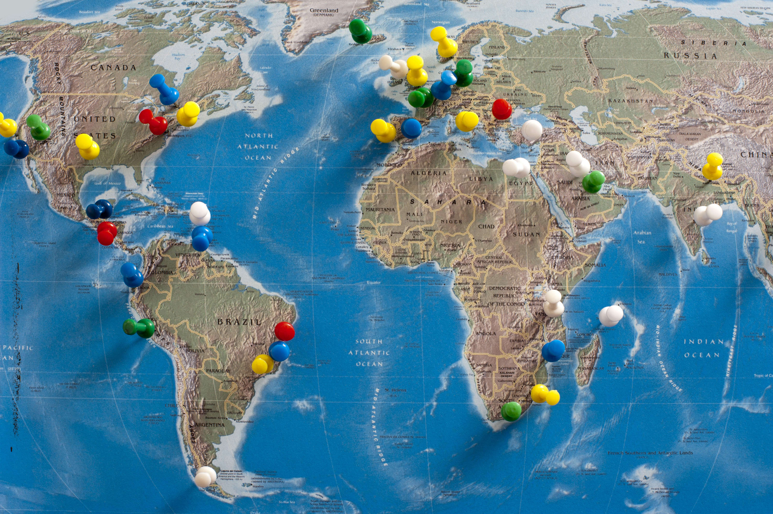 Free stock photo 10699 multi colored thumb tacks inserted in world multi colored thumb tacks inserted in various locations on wall map of the world gumiabroncs Gallery