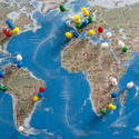 10699   Multi Colored Thumb Tacks Inserted in World Map