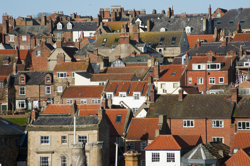View over the rooftops of Whitby in north Yorkshire showing traditional old historical English architecture
